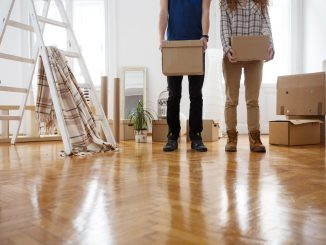 young couple moving boxes.